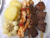 Peruvian culinary : Anticucho de corazon — Stock Photo