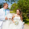 Bride and groom walk — Stock Photo