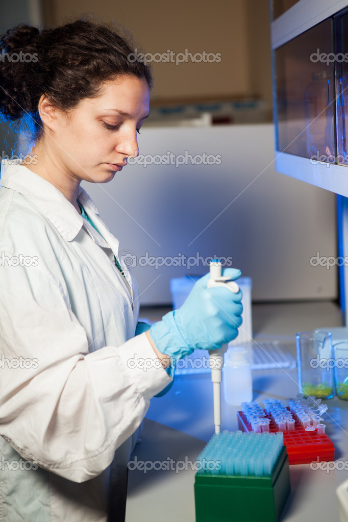 Female researcher making preparation of biological samples — Stock Photo #10682995