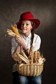 Pretty young farmer girl with a corncob — Stock Photo