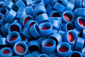 Blue and red plastic caps background — Stock Photo