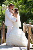 Wedding - happy bride and groom kissing — Stock Photo