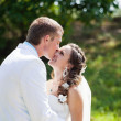 Bride and groom kissing — Stock Photo #9311056