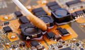 Motherboard with cotton stick — Stock Photo
