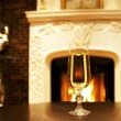 Fire and the glass of Champaign — Stock Photo