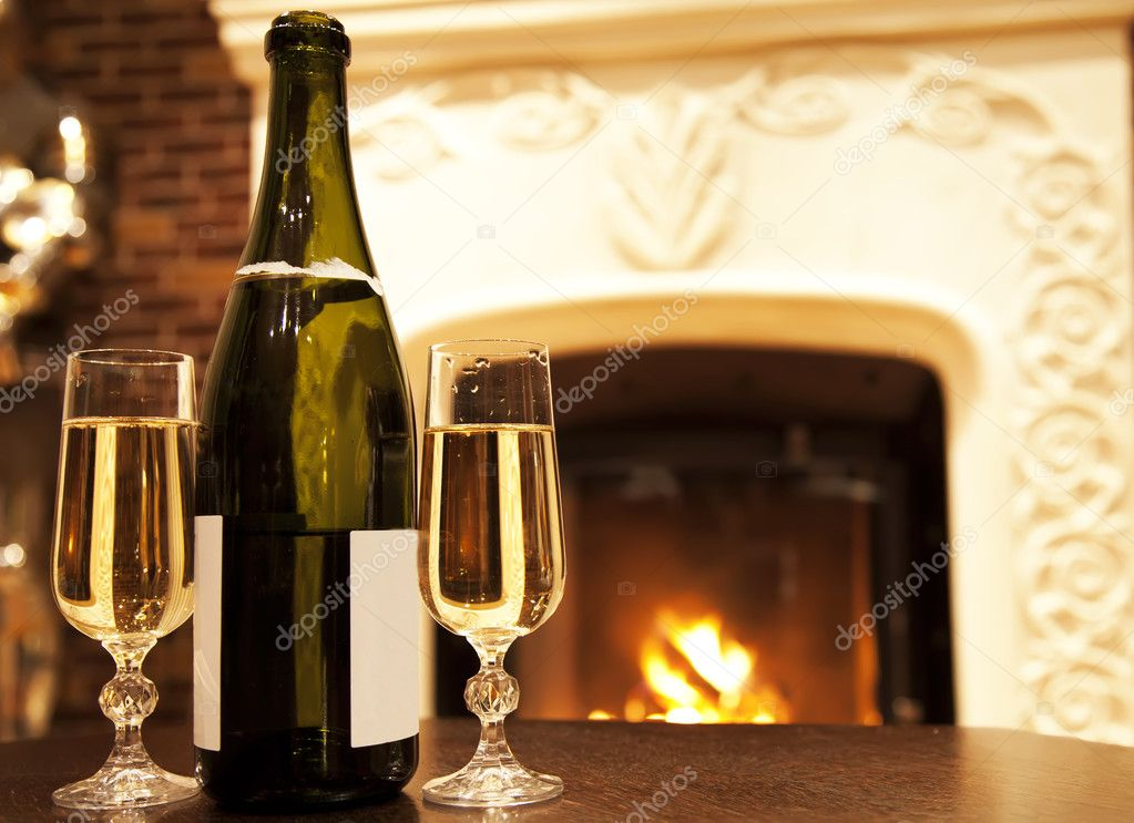 Fire and Champaign near fireplace — Stock Photo #9029914