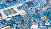 Laptop motherboard in blue color — Stock Photo