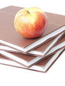 Apple on books — Stock Photo