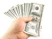 The isolated hundred dollar in a hand — Stock Photo