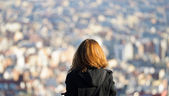 Girl observing a City — Stock Photo