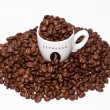 Coffe cup and grouped beans — Stock Photo