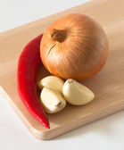 Chili pepper onion and garlic — Stock Photo