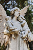 Angel with two little childs — Stock Photo