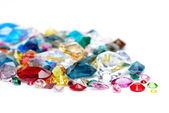 Bright gems isolated on white background — Stock Photo
