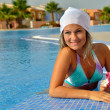 Young woman relaxing at the pool — Stock Photo #10630011