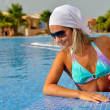 Young woman relaxing at the pool — Stock Photo #10630030