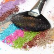 Stock Photo: Professional make-up brush on colorful crushed eyeshadow