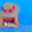Young beautiful woman at the pool in summer — Stock Photo