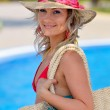 Young beautiful woman at the pool in summer — Stock Photo #10728431