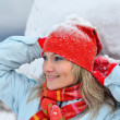 Young woman enjoying the snow — Stock Photo