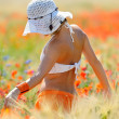 Young beautiful woman on golden wheat field in summer — Stock Photo #10728448