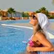 Young woman relaxing at the pool — Stok fotoğraf
