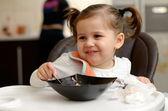 Cute little girl eating cake — Stock Photo