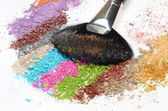 Professional make-up brush on colorful crushed eyeshadow — Stock Photo