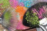 Professional make-up brush on colorful crushed eyeshadow — Stock Photo