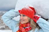 Young woman enjoying the snow — Stock Photo