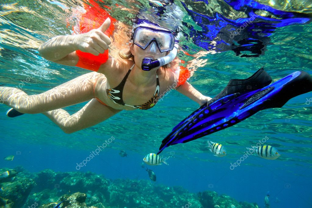 Young woman snorkeling   Stock Photo #10728536