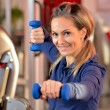 Young woman exercising in the gym — Stock Photo #8890570