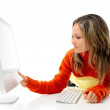 Young woman in front of the computer — Stock Photo