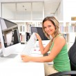 Beautiful young woman at the office — Stock Photo