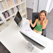 Beautiful young woman at the office — Stock Photo #9033453