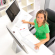 Young woman at the office — Stock Photo #9033479