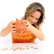 Young woman with in piggy bank against white — Stock Photo