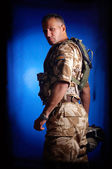 Young man in military uniform — Stock Photo
