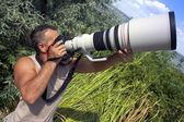 Professional photographer outdoor — Stock Photo