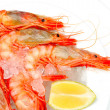 Shrimps with lemon on ice — Stock Photo