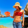 Young woman holding slice of watermelon — Stock Photo