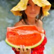 Pretty young woman holding slice of watermelon — Stock Photo