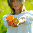 Young woman holding orange — Stock Photo