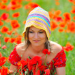 Young beautiful woman on flower field - Stock Photo