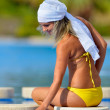 Young woman relaxing at the pool — Stock Photo #9549964