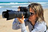 Professional woman photographer outdoor — Stock Photo