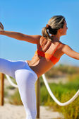 Young woman exercising outdoor — Stock Photo