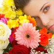 Stock Photo: Beautiful young woman with spring flowers