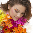 Beautiful young woman with flowers — Stock Photo #9550094