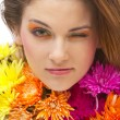 Beautiful young woman with flowers — Stock Photo #9550100